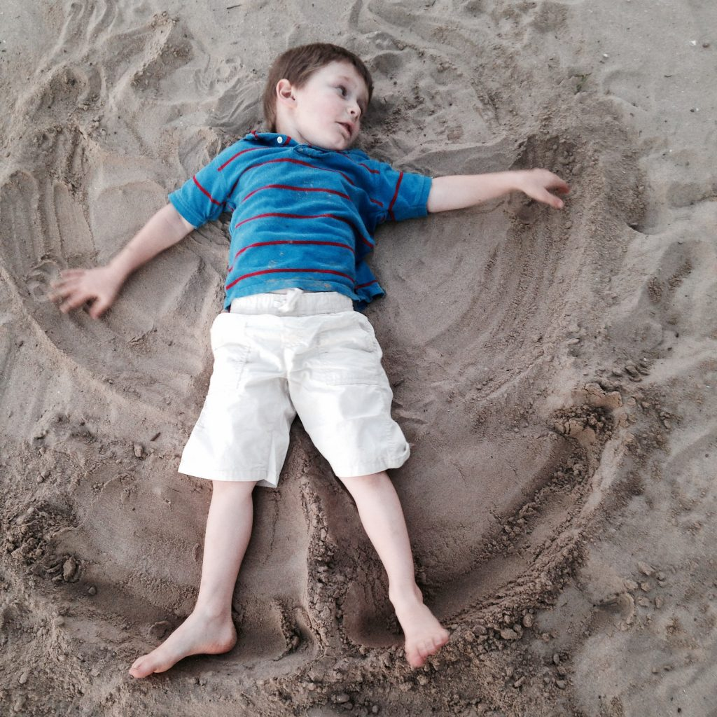 My family and I enjoyed an evening at the beach making sand angles.